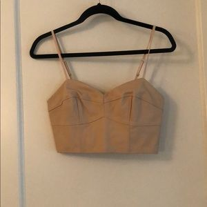 Blush colored faux leather bralette. Size S